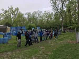 group on paintball field for company event