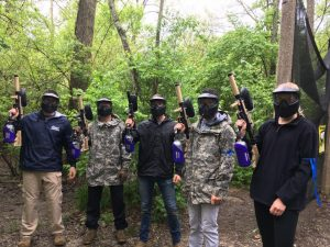 5 paintball players with masks on