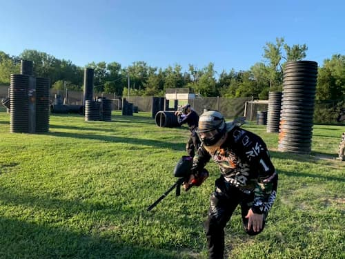paintball player running on field
