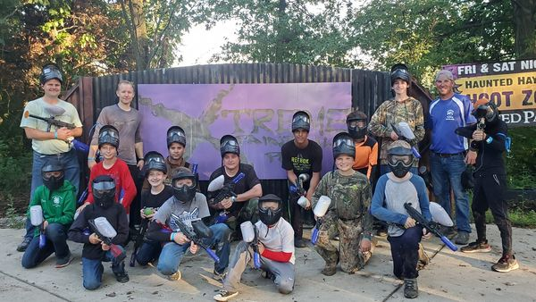 group photo of young boys at paintball park