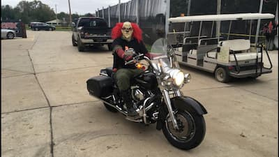 paintball player with Halloween costume on motorcycle
