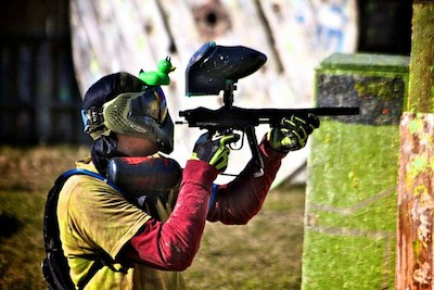 paintball player with pump action gun