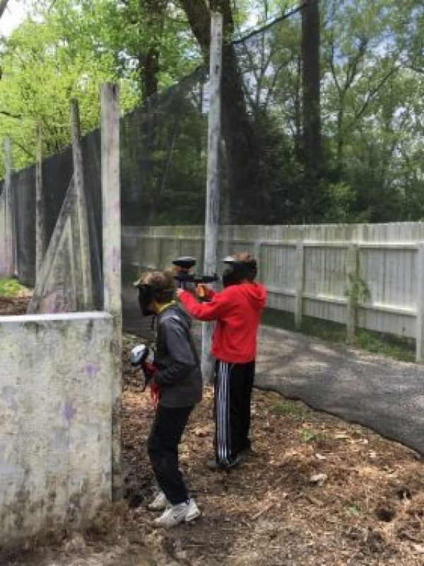 2 boys playing low impact paintball near St. Louis