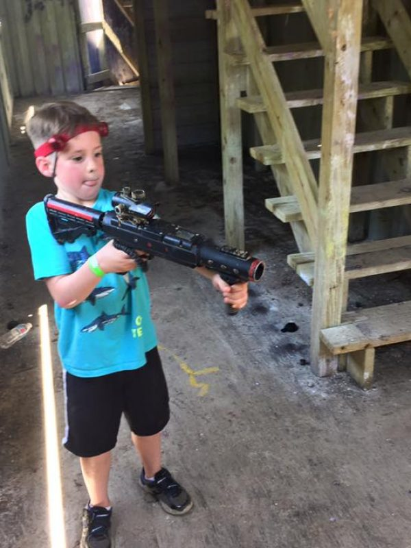 kid playing laser tag near St. Louis