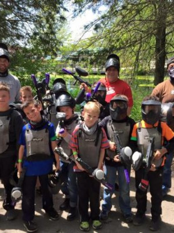 kids and dads at low impact paintball party