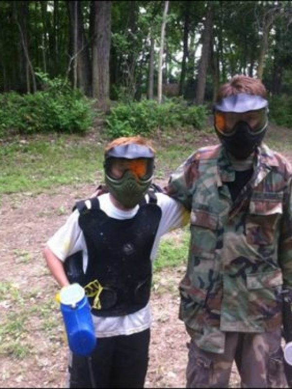 2 young boys on low impact paintball field