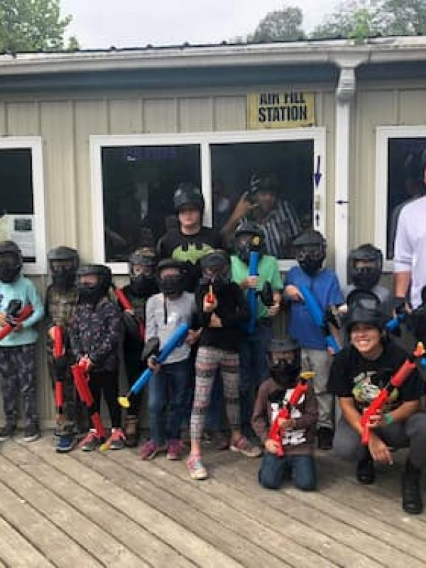 large group of kids at low impact paintball party